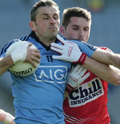 Tight: Dublin's Alan Brogan battles with Daniel Goulding