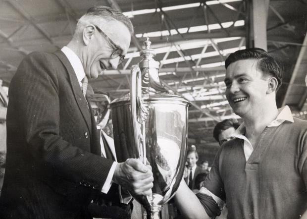Charlie receives the O'Gorman Cup from Ambassador John G Molloy at Wembley in 1966