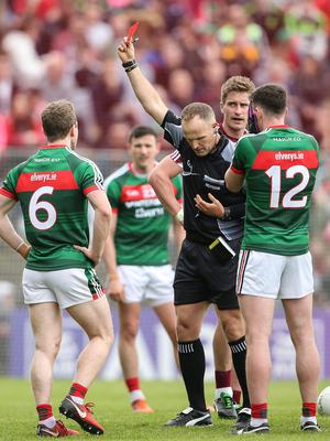 Off: Referee Conor Lane shows Mayo's Diarmuid O'Connor a red card on Sunday
