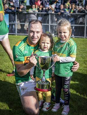 Family fortunes: Dunloy captain Paul Shiels shows off the Antrim hurling title alongside daughters Maeve (2) and Ada (4)