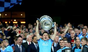 Dublin's David Byrne lifts the Sam Maguire at Croke Park last September after beating Kerry to make it five titles in a row