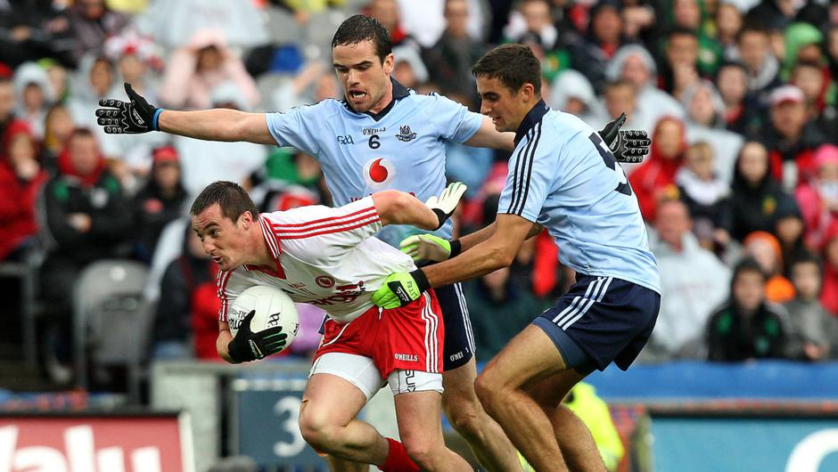 Old times: Dublin's Ger Brennan and James McCarthy get to grips with Brian McGuigan of Tyrone in the 2011 quarter-final