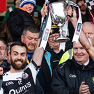 Worth the wait: Kilcoo's joint captains Conor Laverty and Aidan Branagan lift the Seamus McFerran Cup