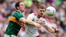 Staying put: Cathal McShane (right), who has rejected a move to Aussie Rules, looks likely to feature for Tyrone against Kerry