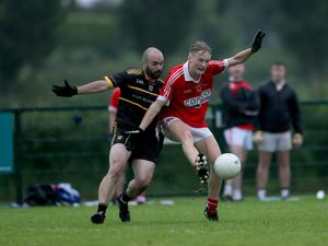 Milestone occasion: St Michael's Ryan Ferris holds off Aodhan Quinn of East Belfast during the historic match in Magheralin