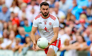 On the ball: Kyle Coney is hoping to play a part in bringing back the good times for Tyrone