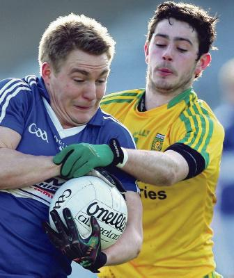 David Conway of Laois, wrestles with Frank McGlynn