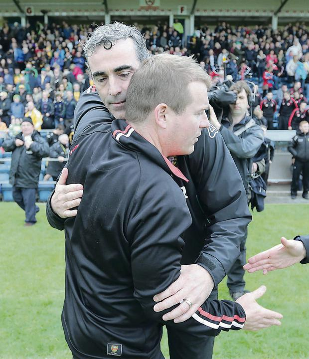 Jim McGuinness with Down counterpart James McCartan