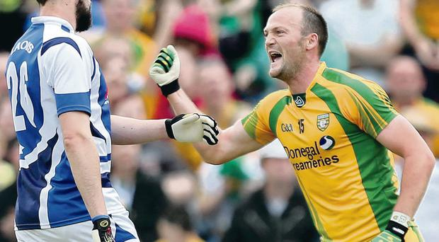 Point made: Donegal's Colm McFadden celebrates a point as Conor Boyle looks away