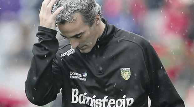 Donegal manager Jim McGuinness dejected near the end of the game
