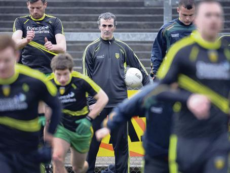 Watching brief: Donegal manager Jim McGuinness oversees training