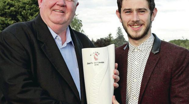 Winner: John P Graham, Vice-Chairman of the UGAAWA, presents July's Merit Award to Ryan McHugh of Donegal