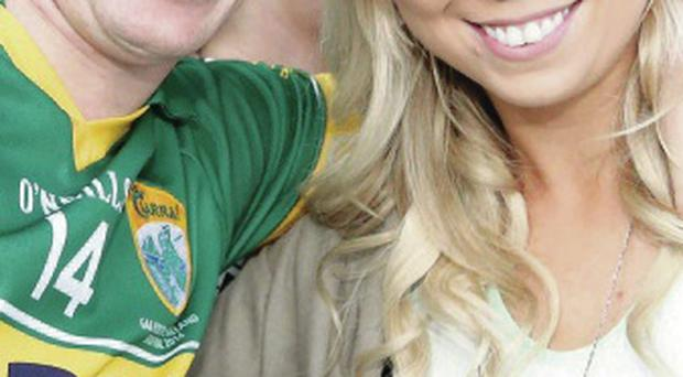 All smiles: Kieran Donaghy with wife Hilary after victory