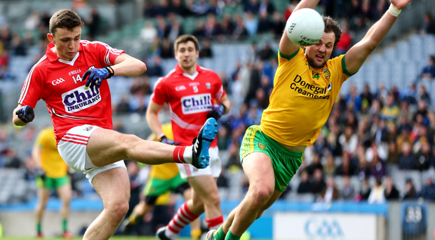 Under pressure: Cork's Mark Collins and Michael Murphy of Donegal