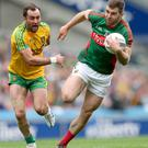 Chase is on: Donegal's Karl Lacey and Seamus O'Shea battle in the All-Ireland quarter-final
