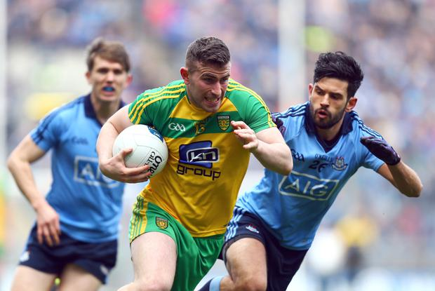 Making ground: Donegal's Patrick McBrearty with Cian O'Sullivan of Dublin