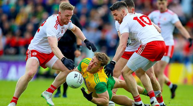 Title goal: Tyrone's Frank Burns and Matthew Donnelly battle it out with Hugh McFadden of Donegal in last season's Ulster SFC semi-final.