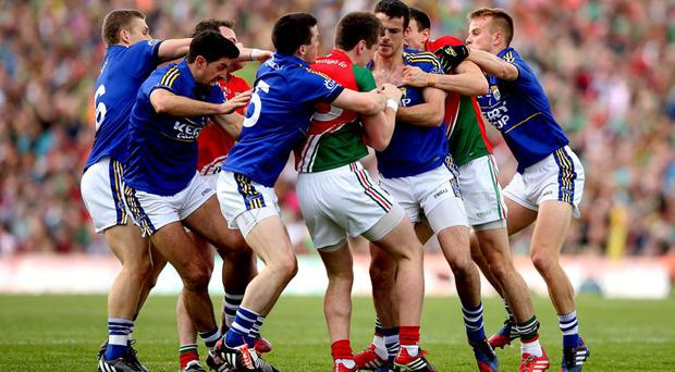 Tangled up: Tempers flare between Kerry and Mayo players in Saturday's epic semi-final replay