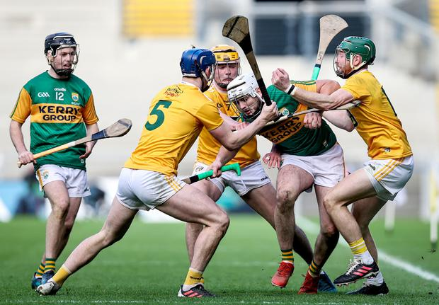 Defiant: Antrim's Gerard Walsh, Joe Maskey and Niall McKenna halt Jason Diggins' progress in the Joe McDonagh Cup final