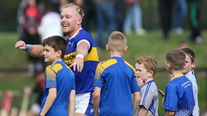 Fun time: Deaglan Murphy celebrates with young fans following Sunday's win