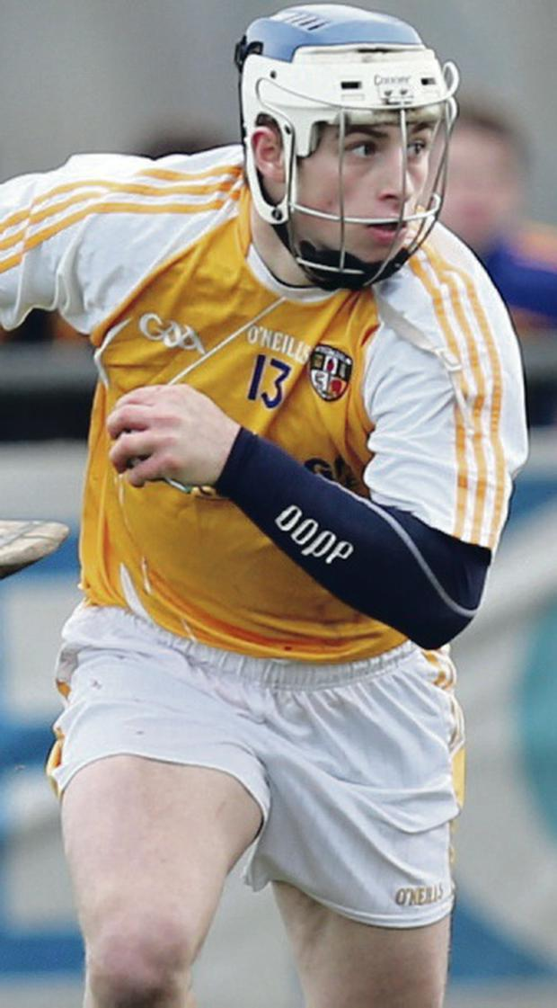 Antrim's Conor Johnston goes on the attack