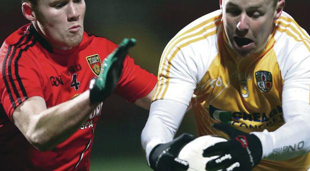 Mature head: Paddy Cunningham (right) believes Antrim can build for the future by giving young talent a chance to shine