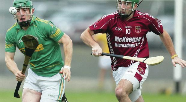 On the ball: Dunloy's Kevin Molloy in action against Cushendall's Sean McAfee