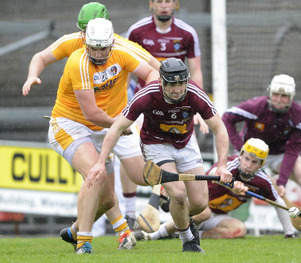 Up close: Antrim's Conor Carson battles it out with Westmeath's Aonghus Clarke at Cusack Park