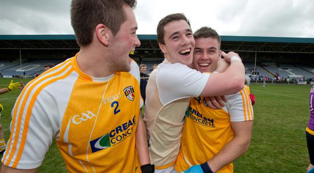 Super day: Antrim's Niall Delargy, Declan Lynch and Patrick McBride celebrate the final whistle