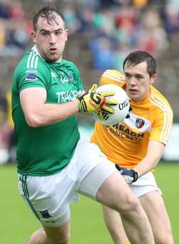Star man: sharpshooter Sean Quigley of Fermanagh with Niall Delargy of Antrim keeping pressure on