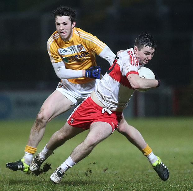 On the ball: Derry's Danny Tallon tries to escape Ruairi McCann