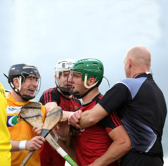 Hold me back: Antrim's Eddie McCloskey and Down's James McGrath are kept apart as tempers begin to rise