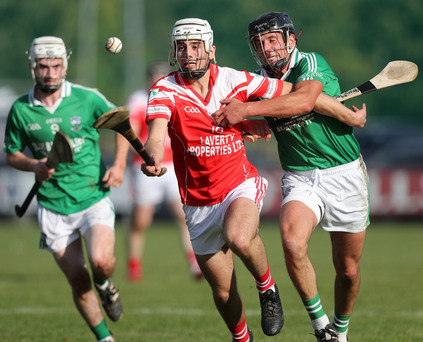Chase is on: Loughgiel's Maol Connolly clashes with Declan McManus of Ballygallet in the AIB Ulster Club Hurling semi-final