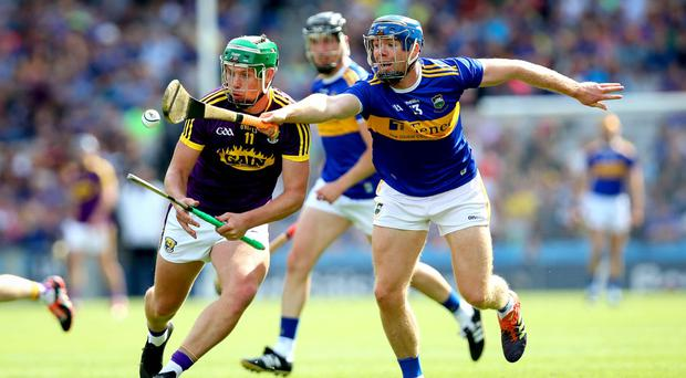 Close encounter: Wexford's Conor McDonald takes on Tipperary scoring ace Jason Forde
