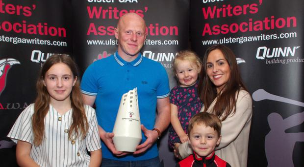 Shooting star: UGAAWA September Merit Award winner Paddy Cunningham of Lamh Dhearg with wife Claire and family Avien, Padráig and Aoife