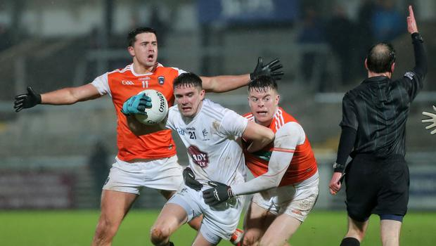 Gripping affair: Armagh's Aidan Nugent clashes with David Hyland