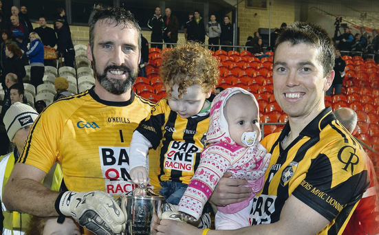 Family fortunes: Crossmaglen's Paul Hearty with his children Breanne and Oran and Stephen Kernan with his daughter Sophie with the Gerry Fagan Cup