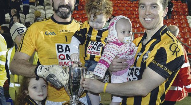 Family affair: Crossmaglen's Paul Hearty with his children Breanne and Oran and Stephen Kernan with his daughter Sophie