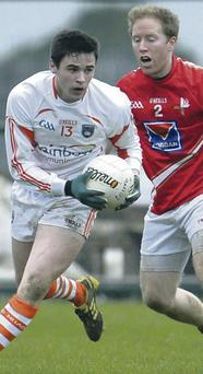 Battle: Armagh's Eddie English with Louth's Ronan Greene