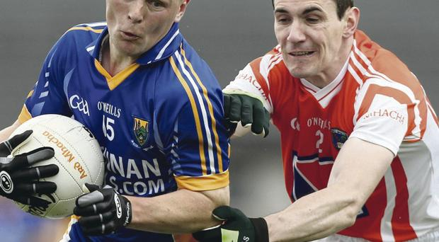 Andy Mallon (right) makes his comeback to the Armagh for the Derry clash after missing all of the current year