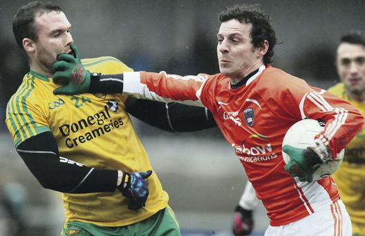 Armagh's Jamie Clarke gives Donegal's Neil McGee the brush off