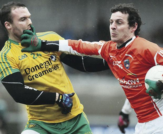 Jamie Clarke (right) declared himself available for Paul Grimley's Armagh on Sunday hours after returning from America