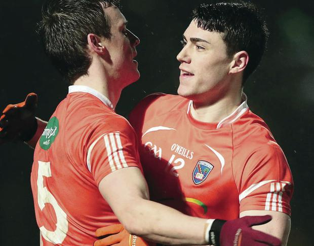 Armagh's Mark Shields and Caolan Rafferty celebrate the end of the league clash