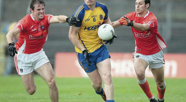 Closed down: Roscommon's Niall Daly is chased by Kevin Dyas and Jamie Clarke