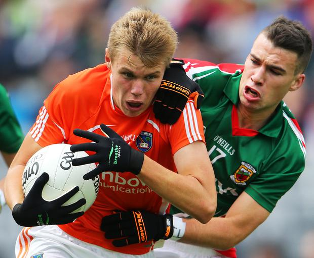Locking horns: Mayo's Stephen Brennan and Oisin O'Neill clash