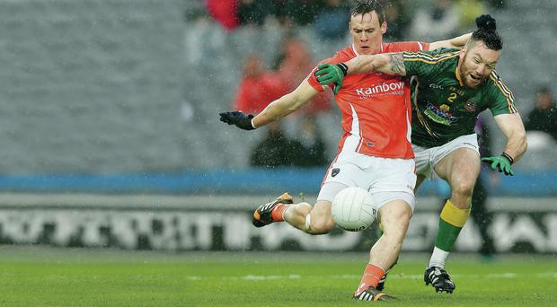 Rain on: Mark Shields of Armagh battles with Mikey Burke of Meath