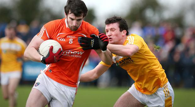 Hands on: Armagh's Aaron Findon tries to evade Antrim's Dermott McAleese