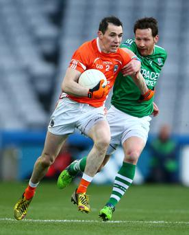 Don't hold back: Armagh's Andy Mallon is tackled by Niall Cassidy of Fermanagh