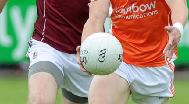 Posing a threat: Armagh's James Morgan tries to launch an attack after getting away from Johnny Duane of Galway