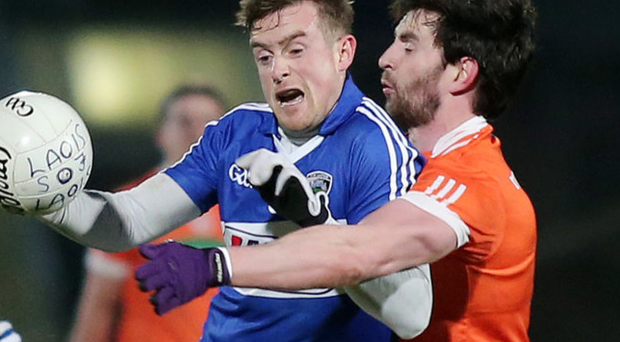 Man marked: Armagh's Aaron Findon with Kieran Lillis